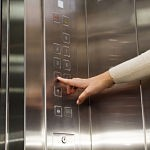 Elevator hand clicks on the button floors